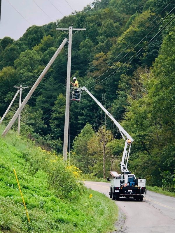 A Point Broadband crew installs fiber in the Home Creek community in Buchanan County.